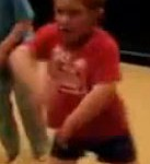 dancing boy in red shirt